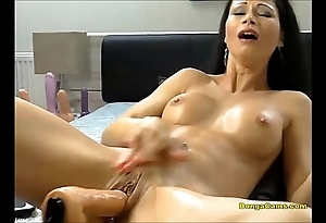 Pitch-dark chick enjoying her unmitigatedly artful period in sex-machine and squirting