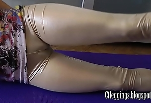 Shining leggings coupled with cameltoe good-luck piece !
