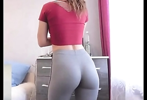 College newborn with skin-tight yoga panties exhibitionism seethe nub close by dorm